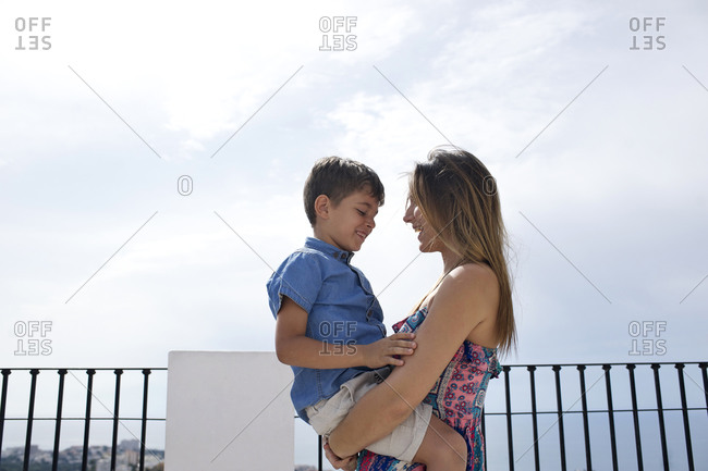 Affectionate moment between mother and son at a scenic overlook