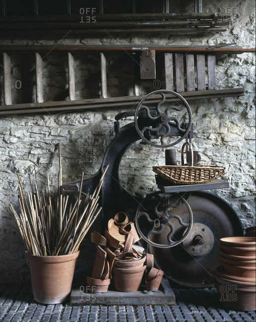 Gardening tools against a white wall