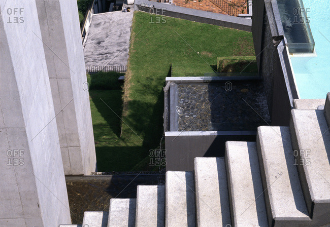 Mexico City, Mexico - January 10, 2011: Concrete, gardens, waterfalls and steps at Casa en el aire, designed by Agustin Hernandez