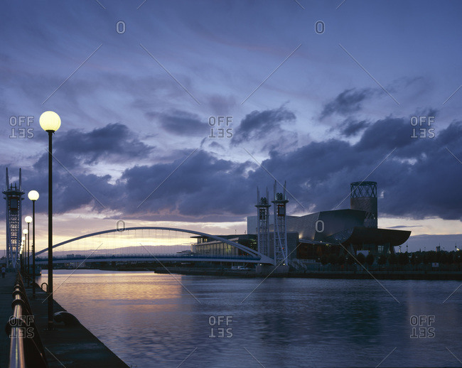 Manchester, United Kingdom - June 27, 2005: Dusk at Lowry Arts Centre, designed by Michael Wilford and Partners and engineered by Buro Happold