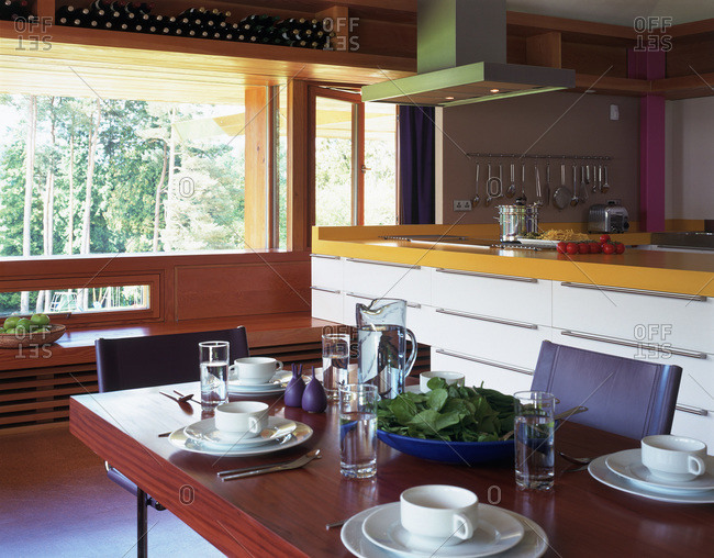 East Sussex, United Kingdom - March 11, 2009: View across dining table to kitchen inside Lone Oak Hall, designed by Michael Wilford