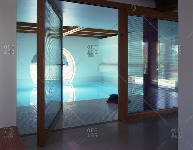 East Sussex, United Kingdom - March 11, 2009: Swimming pool with door open at Lone Oak Hall, designed by Michael Wilford