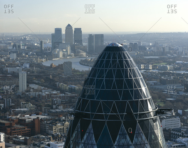 London, United Kingdom - November 27, 2008: Canary Wharf on the horizon and top of the Gherkin, 30 St. Mary Ave