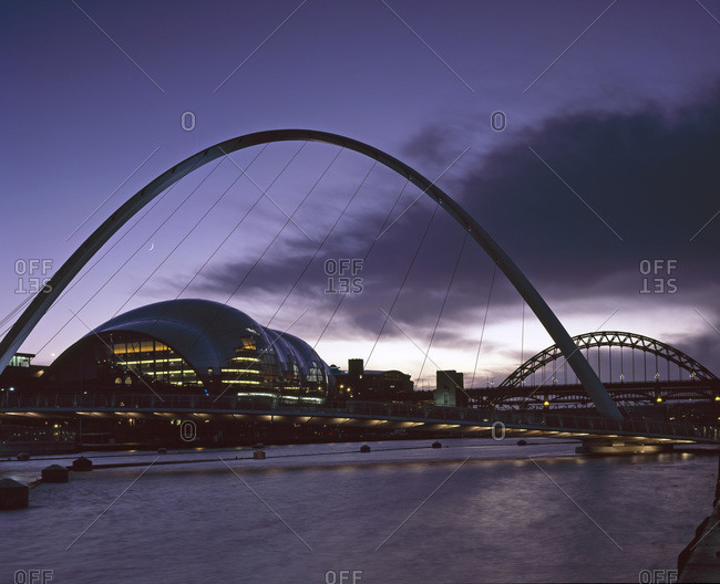 Gateshead, Tyne and Wear, England - November 17, 2008: Dusk shot of The Sage Gateshead, designed by Foster and Partners, seen through Millennium Bridge