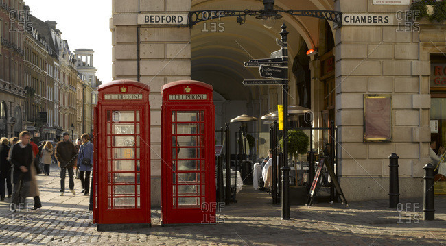 London, United Kingdom - May 20, 2015: Red phone boxes in Covent Garden