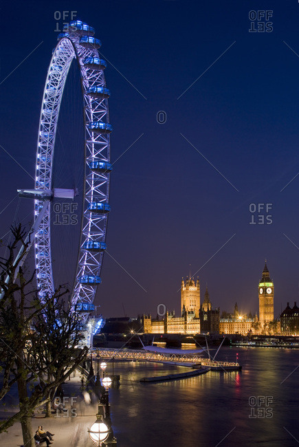 London, United Kingdom - January 24, 2008: London Eye, designed by Marks Barfield Architects, and the Houses of Parliament