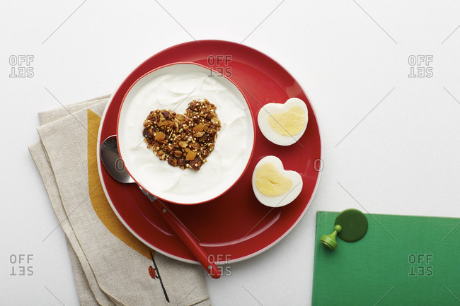 Heart-shaped granola and hard boiled eggs