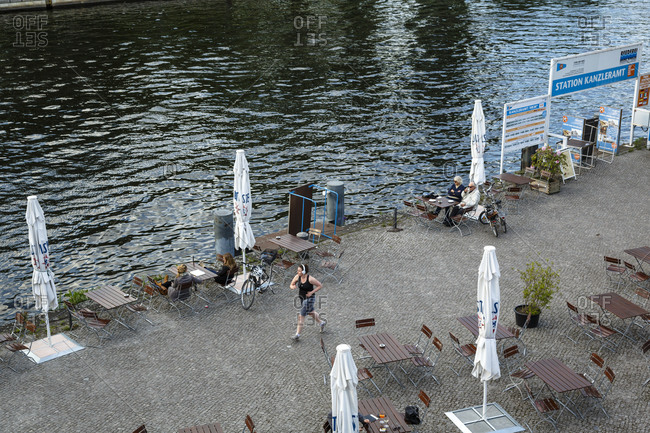 May 21, 2015: A woman jogging by the Spree, Tiergarten, Berlin, Germany