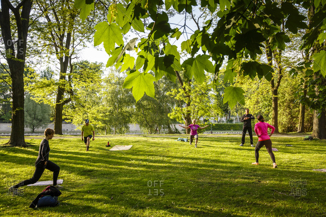 May 21, 2015: People stretching at Tiergarten park, Berlin, Germany