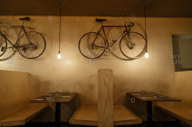May 23, 2015: A restaurant with bicycles hanging from the wall in Prenzlauer Berg, Berlin, Germany
