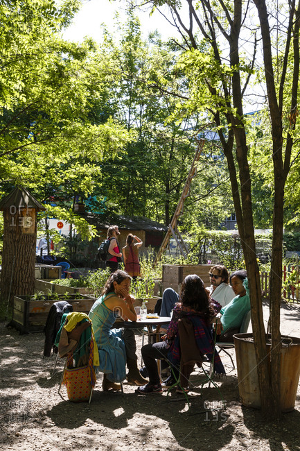 May 24, 2015: People sitting at the Prinzessinnengarten urban gardening project, Kreuzberg, Berlin, Germany
