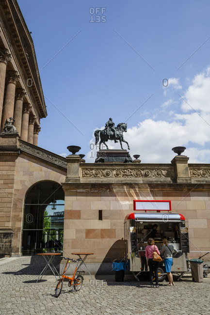 May 22, 2015: Two women at a food stand outside of the Alte Nationalgalerie at the Museumsinsel, Mitte, Berlin, Germany