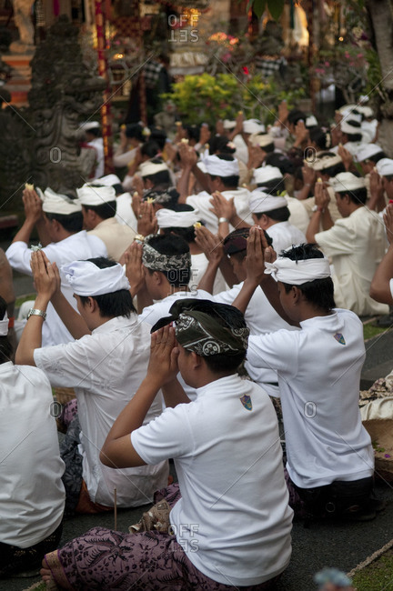 Indonesia, Southeast Asia - July 13, 2015: A group of men praying in a religious celebration, Ubud