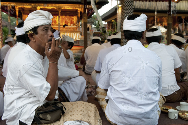 Indonesia, Southeast Asia - July 13, 2015: A man smoking during a religious festival in Ubud