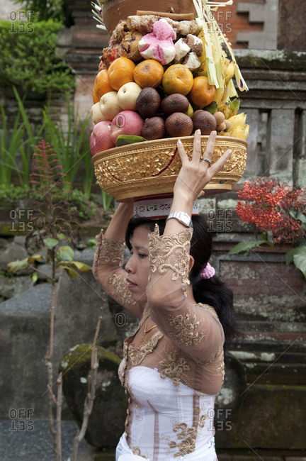 Indonesia, Southeast Asia - July 13, 2015: An Indonesian woman makes an offering in a temple, Ubud