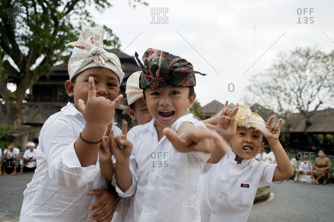 Indonesia, Southeast Asia - July 13, 2015: Young Indonesian boys playing at a religious festival Ubud