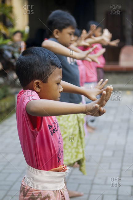 Indonesia, Southeast Asia - July 13, 2015: Boys practicing a Balinese dance in Ubud