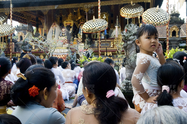 Bali, Indonesia - July 13, 2015: Women celebrating a religious festival in a temple, Ubud