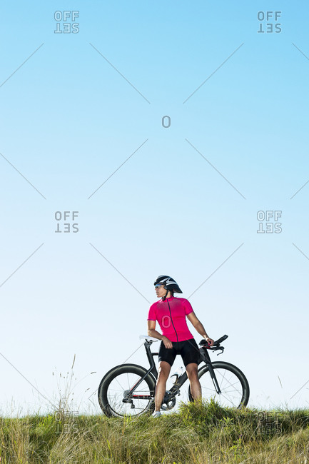 Cyclist posing with bicycle