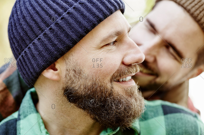 Close up of gay couple smiling
