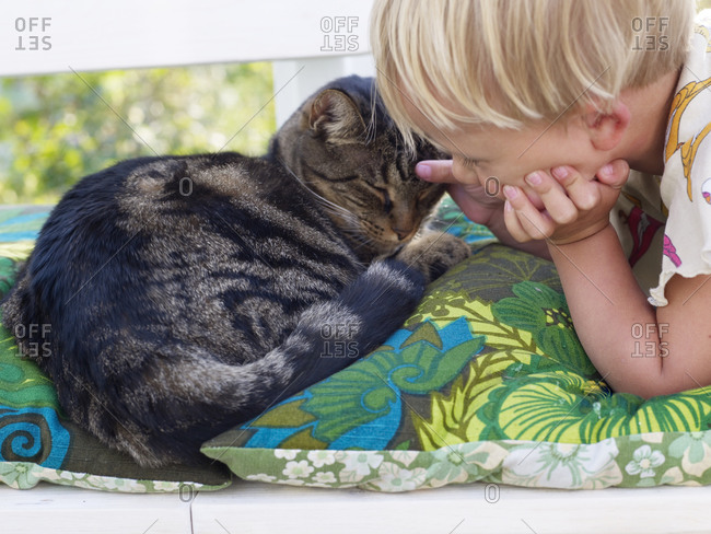 Girl stroking sleeping cat