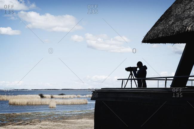 Birdwatcher looking over a marsh