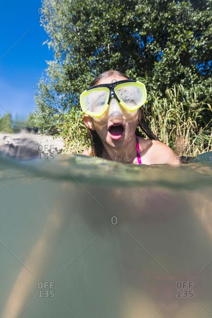Girl in scuba mask taking a breath