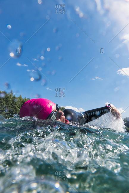 Person swimming in pink cap