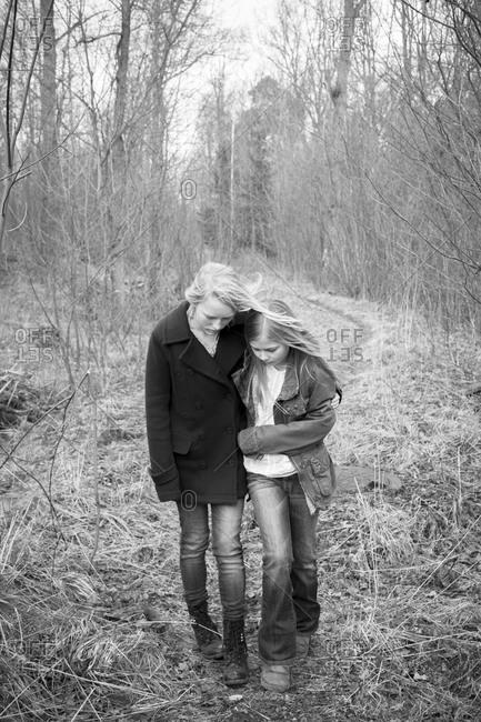 Girls walking together through forest