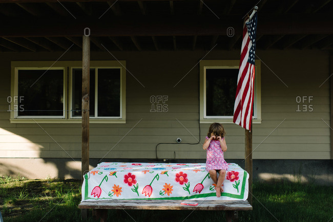 Girl on a picnic table