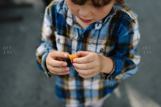 Boy holding a golden raspberry