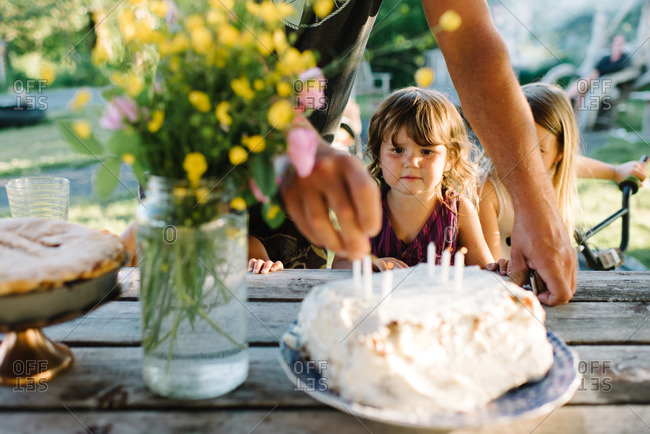 Little girl looking at birthday cake