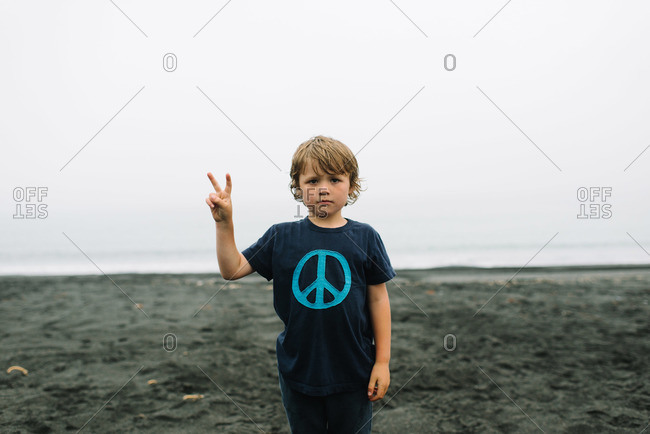 Boy giving a peace sign