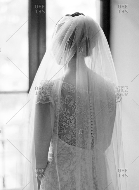 A bride in a lace gown with veil