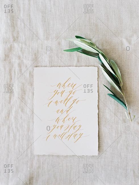 A bible verse written in calligraphy
