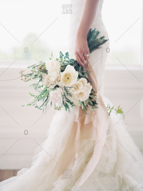 A bride walks with her bouquet