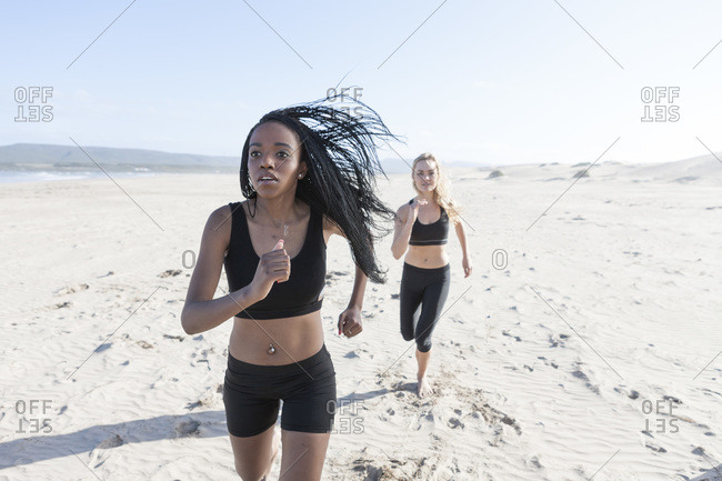Two women jogging on the beach