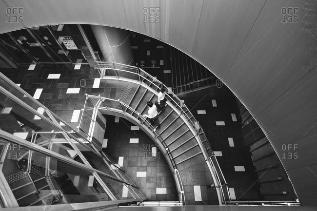 Tokyo, Japan - June 18. 2015: Looking down the stairs inside the Mode Gakuen Cocoon Tower in Shinjuku, Tokyo, Japan