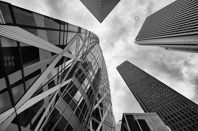 Tokyo, Japan - June 18, 2015: Looking up at the Cocoon Tower from the ground in Shinjuku, Tokyo, Japan