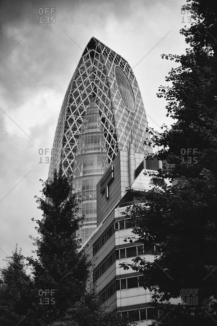 Tokyo, Japan - June 18, 2015: The Cocoon skyscraper  and Tokyo Post Office Building