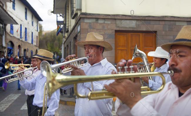 June 21, 2015: Peruvian men playing trumpets at a celebration