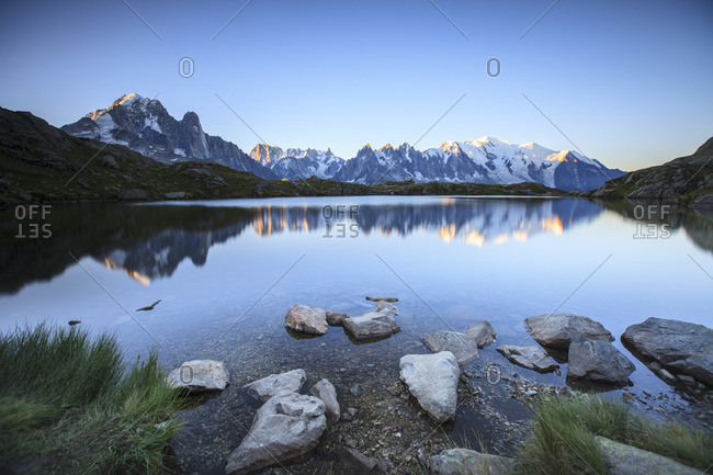 Mont Blanc range reflected at sunrise from the shore of Lac des Cheserys, Aiguilles Rouges, Chamonix, Haute Savoie, French Alps, France, Europe