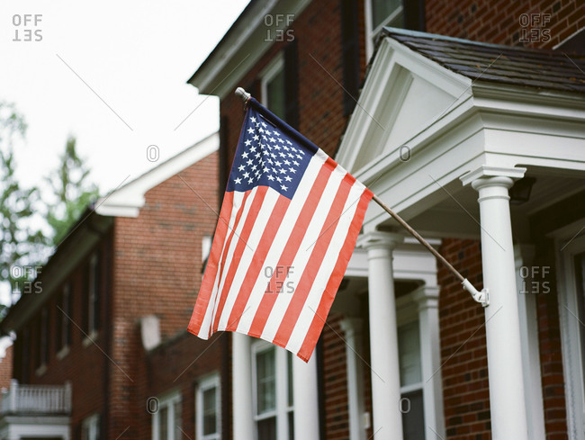 American flag hanging from a front porch
