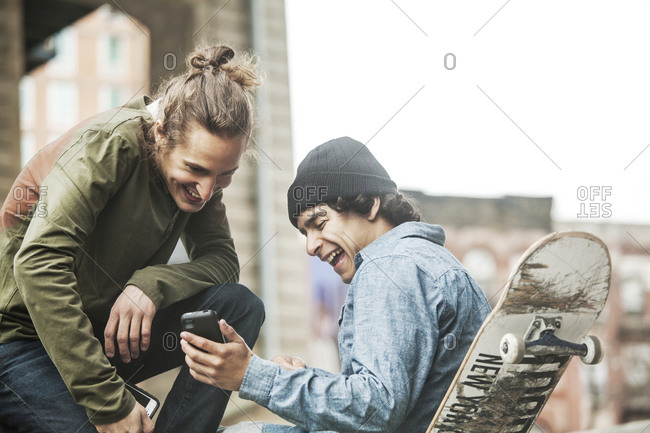 Skaters watching a viral video on a phone