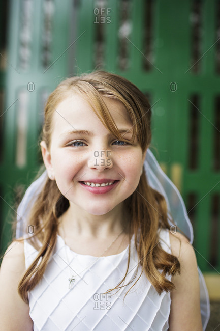 Portrait of little girl with big grin and veil