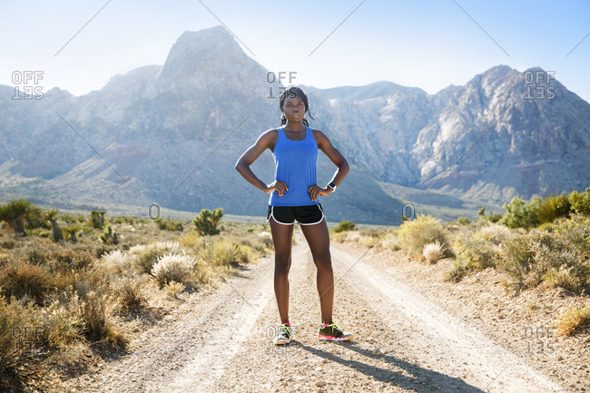 Athletic woman standing in mountain prairie