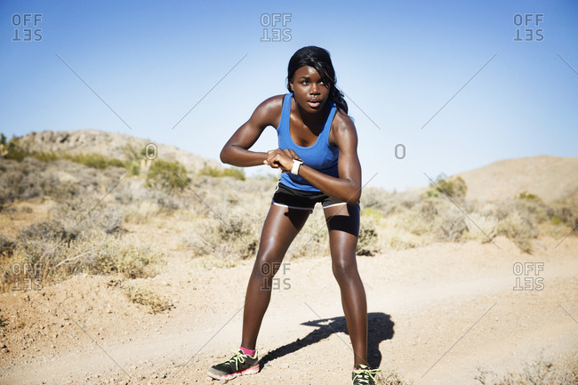 Athletic woman in remote setting ready for a run
