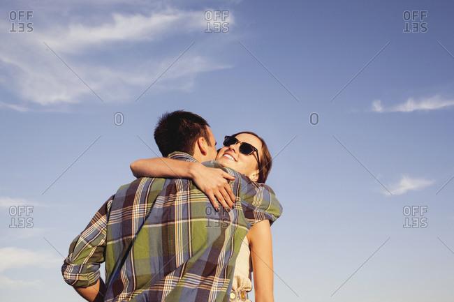 A couple hugs in Venice, California