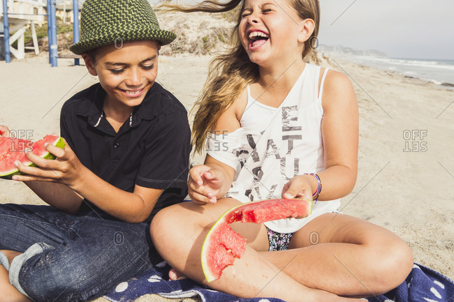 Siblings have a picnic on the beach