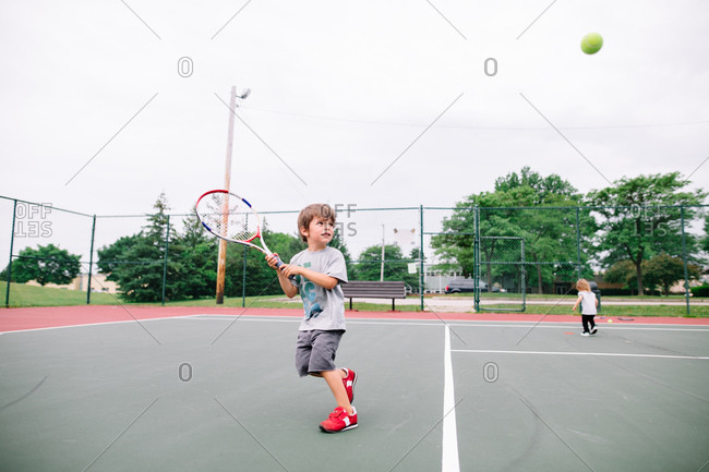 Boy playing a game of tennis